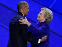 US Democratic presidential nominee Hillary Clinton embraces President Barack Obama on stage during the Democratic National Convention at the Wells Fargo Center in Philadelphia, Pennsylvania on July 27, 2016