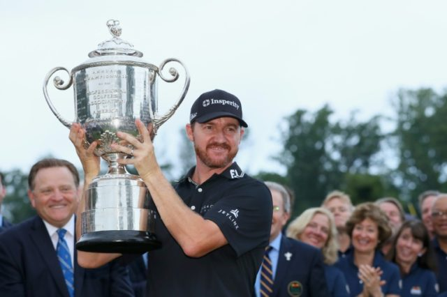 Jimmy Walker of the United States celebrates with the Wanamaker Trophy during the trophy presentation ceremony after winning the 2016 PGA Championship at Baltusrol Golf Club on July 31, 2016 in Springfield, New Jersey