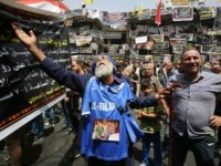 An Iraqi man, whose sons have been killed in a suicide bombing that ripped through Baghdad's busy shopping district of Karrada, reacts at the site of the attack on July 6, 2016