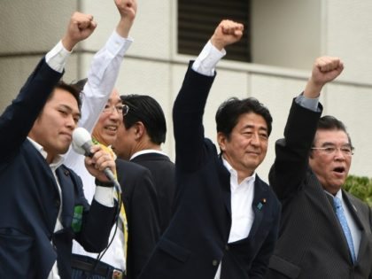 Japanese Prime Minister Shinzo Abe (2nd R) campaigns in Tokyo on July 9, 2016, on the eve of upper house elections