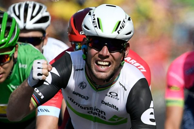 Mark Cavendish celebrates as he crosses the finish line to clinch his 29th stage win in the Tour de France, with victory in Montauban, on July 7, 2016