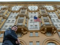 A Russian police officer stands guard outside the US Embassy in Moscow