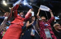 Delegates cheer as former president Bill Clinton speaks on day two of the Democratic National Convention in Philadelphia, Pennsylvania