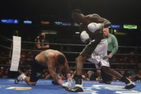 Chris Arreola (L) is taken down by WBC World Heavyweight Champion Deontay Wilder during a title fight in Birmingham, Alabama, on July 16, 2016