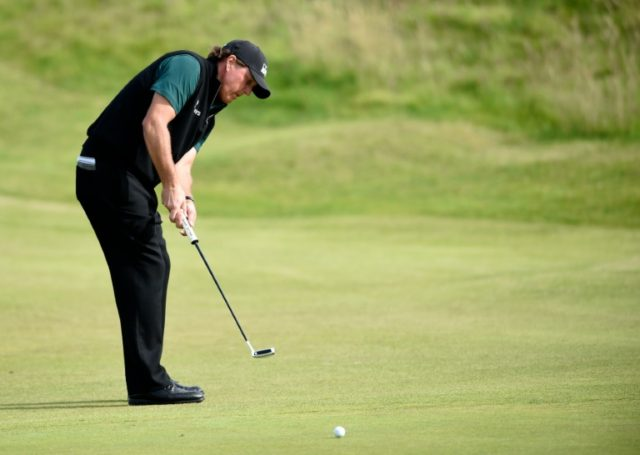 US golfer Phil Mickelson putts on the 15th Green during his first round 63 on the opening day of the 2016 British Open Golf Championship at Royal Troon in Scotland on July 14, 2016