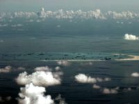 This aerial photograph taken from a military aircraft shows alleged on-going reclamation by China on Mischief Reef in the Spratly group of islands in the South China Sea in May 2015