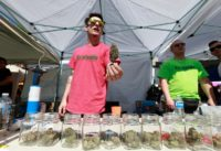 A vendor sells pot on April 20, 2016 at Sunset Beach in Vancouver, Canada