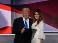 Presumptive Republican presidential candidate Donald Trump stands on stage with his wife Melania Trump following her address to delegates at the Republican National Convention in Cleveland, Ohio, on July 18, 2016