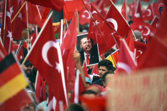 Supporters of Turkish President Recep Tayyip Erdogan attend a rally in Cologne, on July 31, 2016