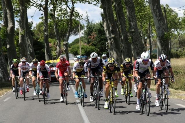 Cyclists ride during the 103rd edition of the Tour de France cycling race between Montpellier and Chalet-Reynard,  on July 14, 2016