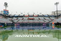 Rain covers center court on day one of the WTA Rogers Cup, at Uniprix Stadium in Montreal, Quebec, on July 25, 2016