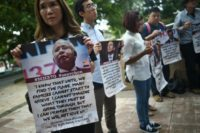 Relatives of passengers, missing from Malaysia Airlines flight MH370, demonstrate at the Malaysian federal administrative centre in Putrajaya, outside Kuala Lumpur, on July 22, 2016