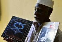 Niger's self-taught legendary musician Mamman Sani poses with his first and second albums