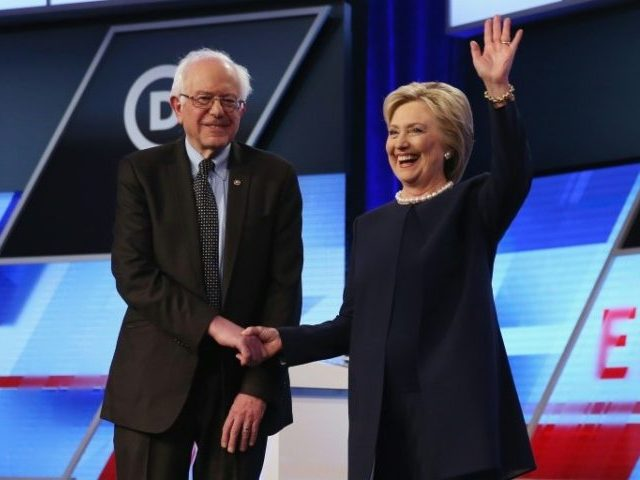 "Bernie Sanders (L), pictured with Hillary Clinton on March 9, 2016, says, ""I intend to do everything I can to make certain she will be the next president of the United States"""