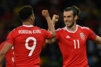 Wales forward Hal Robson-Kanu (L) celebrates after scoring a goal with Gareth Bale (R) during the Euro 2016 quarter-final against Belgium, on July 1, 2016