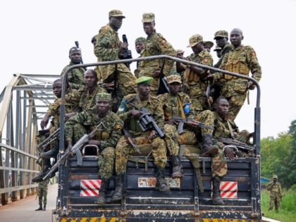 Uganda troops drive towards Juba, South Sudan, at the Nimule border point on July 14, 2016 in an evacuation mission to extract 3,000 Ugandan civilians
