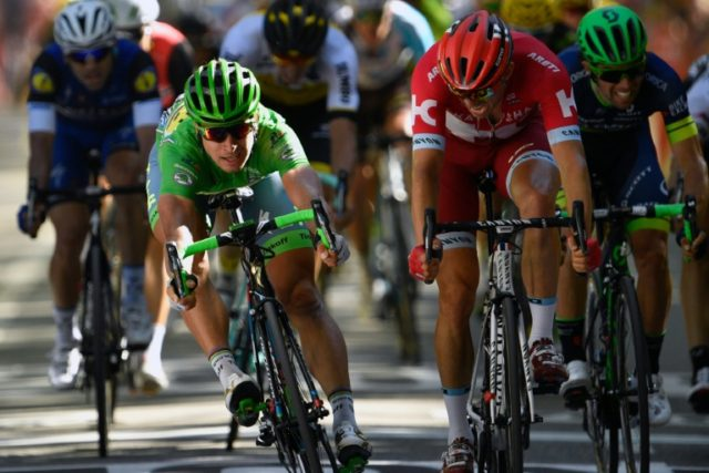 Slovakia's Peter Sagan (left) crosses the finish line at the end of the 16th stage of the Tour de France on July 18, 2016 between Moirans-en-Montagne and Berne