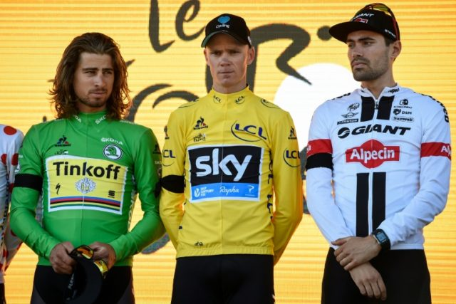 (From L) Slovakia's Peter Sagan, Great Britain's Christopher Froome and Netherlands' Tom Dumoulin wear black bands in tribute to the victims of the Nice attack, after the thirteenth stage of the Tour de France on July 15, 2016