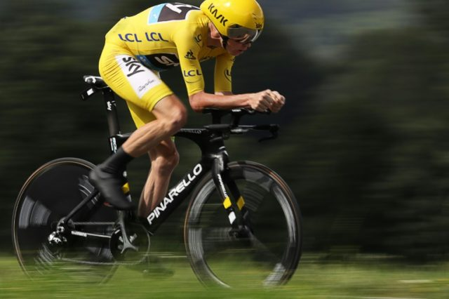 Great Britain's Chris Froome, wearing the overall leader's yellow jersey, rides in the 17km individual time-trial, the 18th stage of the Tour de France, on July 21, 2016