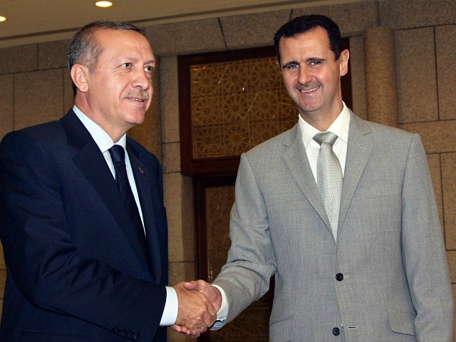 FILE - In this Monday, Oct. 11, 2010 file photo, Syrian President Bashar Assad, right, shakes hands with Turkish Prime Minister Recep Tayyip Erdogan, left, at al-Shaab presidential palace in Damascus, Syria. Within minutes of news breaking of a coup against Recep Tayyeb Erdogan, government-held areas in Syria broke out in celebratory gunfire that lasted throughout the night. In bars across the capital Damascus, revelers celebrated the news, drinking to the removal of Turkey's strongman they blame for fueling their country's five-year civil war. But Erdogan survived, and judging by the surprise reversal of rebel fortunes in Aleppo this week, so has his support for the rebels. (AP Photo/Bassem Tellawi, File)