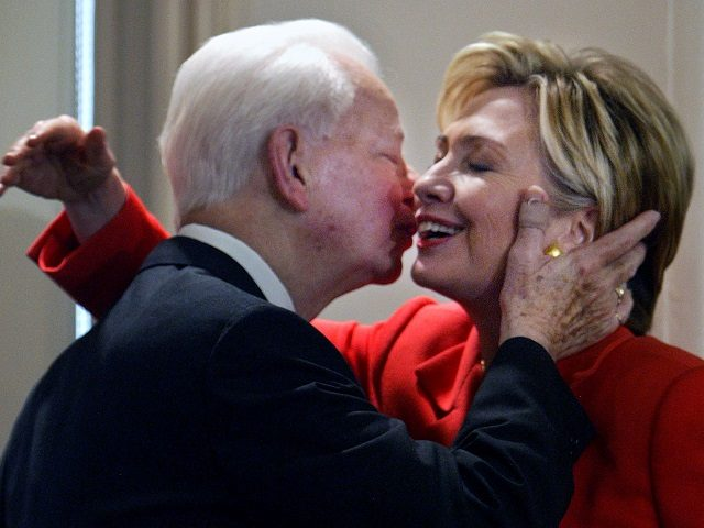 """FILE - In this July 26, 2004 file photo, Sen. Hillary Clinton, D-NY, is embraced by Sen. Robert Byrd, D-W.Va., at a bookstore in New York where they were launching his book """"Losing America: Confronting a Reckless and Arrogant Presidency."""" Just hours before she was to speak at the Democratic …"""