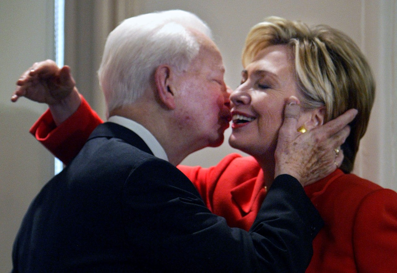 "FILE - In this July 26, 2004 file photo, Sen. Hillary Clinton, D-NY, is embraced by Sen. Robert Byrd, D-W.Va., at a bookstore in New York where they were launching his book ""Losing America: Confronting a Reckless and Arrogant Presidency."" Just hours before she was to speak at the Democratic National Convention in Boston, Clinton introduced Byrd as her mentor and told the audience that he has been a champion of the U.S. Constitution. Byrd a fiery orator versed in the classics and a hard-charging power broker who steered billions of federal dollars to the state of his Depression-era upbringing, died Monday, June 28, 2010. (AP Photo/Bebeto Matthews, File)"
