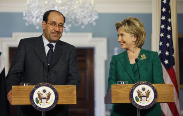 Secretary of State Hillary Rodham Clinton, right, smiles at Iraqi Prime Minister Nouri al-Maliki as they talk with reporters during a news conference at the State Department in Washington, Friday, July 24, 2009. (AP Photo/Pablo Martinez Monsivais)