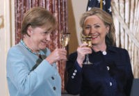 German Chancellor Angela Merkel and Secretary of State Hillary Rodham Clinton make a toast during a State Luncheon in honor of the German chancellor, Tuesday, June 7, 2011, at the State Department in Washington.  (AP Photo/Manuel Balce Ceneta)