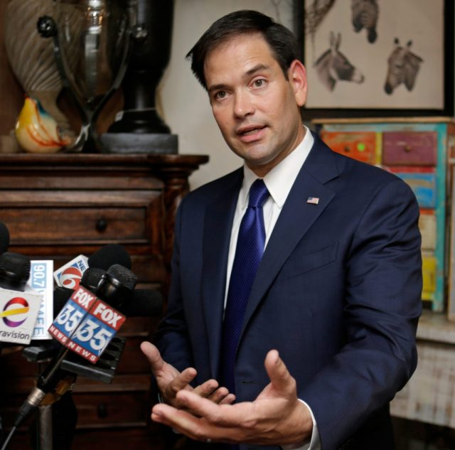 Sen. Marco Rubio, R-Fla. answers questions at a news conference Tuesday, July 19, 2016, in Orlando, Fla. Rubio visited several businesses that suffered significant losses due to last month's attack on the Pulse nightclub. (AP Photo/John Raoux)