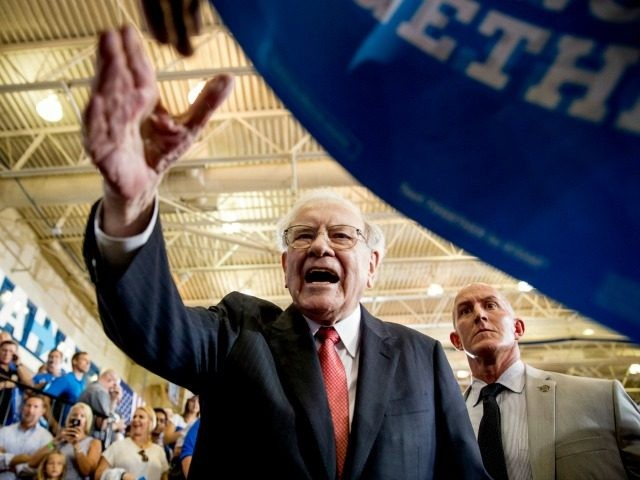 Berkshire Hathaway Chairman and CEO Warren Buffett shakes hands with members of the audience after speaking at a rally for Democratic presidential candidate Hillary Clinton at Omaha North High Magnet School in Omaha, Neb., Monday, Aug. 1, 2016. (