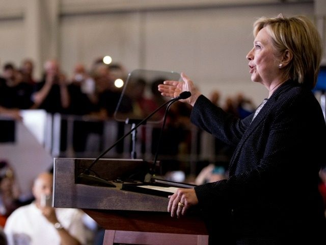 Democratic presidential candidate Hillary Clinton gives a speech on the economy after touring Futuramic Tool & Engineering, in Warren, Mich., Thursday, Aug. 11, 2016. (