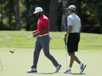 In this Aug. 7, 2016, photo, President Barack Obama and Los Angeles Clippers point guard Chris Paul walk on the first green during a round of golf at Farm Neck Golf Course in Oak Bluffs, Mass., on Martha's Vineyard. When Obama goes on vacation, he plays a lot of golf. …
