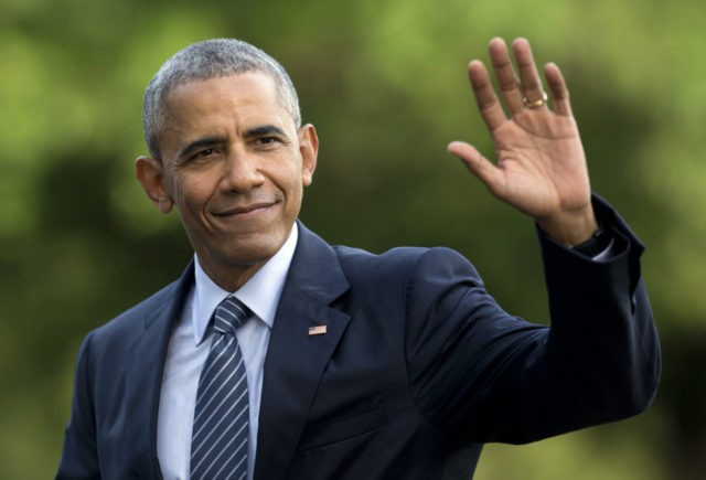 FILE - In this July 5, 2016 photo, President Barack Obama waves as he walks across the South Lawn of the White House, in Washington, as he returns from Charlotte, N.C. where he participated in a campaign event with Democratic presidential candidate Hillary Clinton. Obama is interrupting his summer vacation …