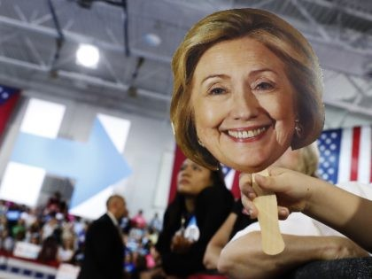 Hunter Lassus, 7, of Seven Hills, Ohio, holds an image of Democratic presidential candidate Hillary Clinton during a campaign event at John Marshall High School in Cleveland, Wednesday, Aug. 17, 2016. (AP Photo/Carolyn Kaster)