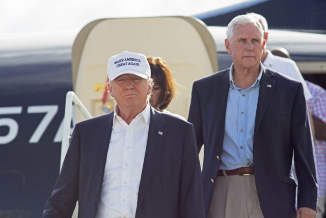 Republican presidential candidate Donald Trump, followed by his running mate, Indiana Gov. Mike Pence, emerges from his plane as he arrives to tour the flood damaged city of Baton Rouge, La., Friday, Aug. 19, 2016. (AP Photo/Max Becherer)