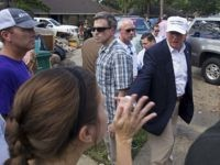 Republican presidential candidate Donald Trump greets flood victims during a tour of flood damaged homes in Denham Springs, La., Friday, Aug. 19, 2016. (AP Photo/Max Becherer)