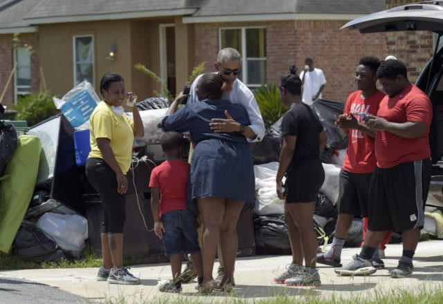 President Barack Obama greets residents as he tours Castle Place, a flood-damaged area of Baton Rouge, La., Tuesday, Aug. 23, 2016. Obama is making his first visit to flood-ravaged southern Louisiana as he attempts to assure the many thousands who have suffered damage to their homes, schools and businesses that …