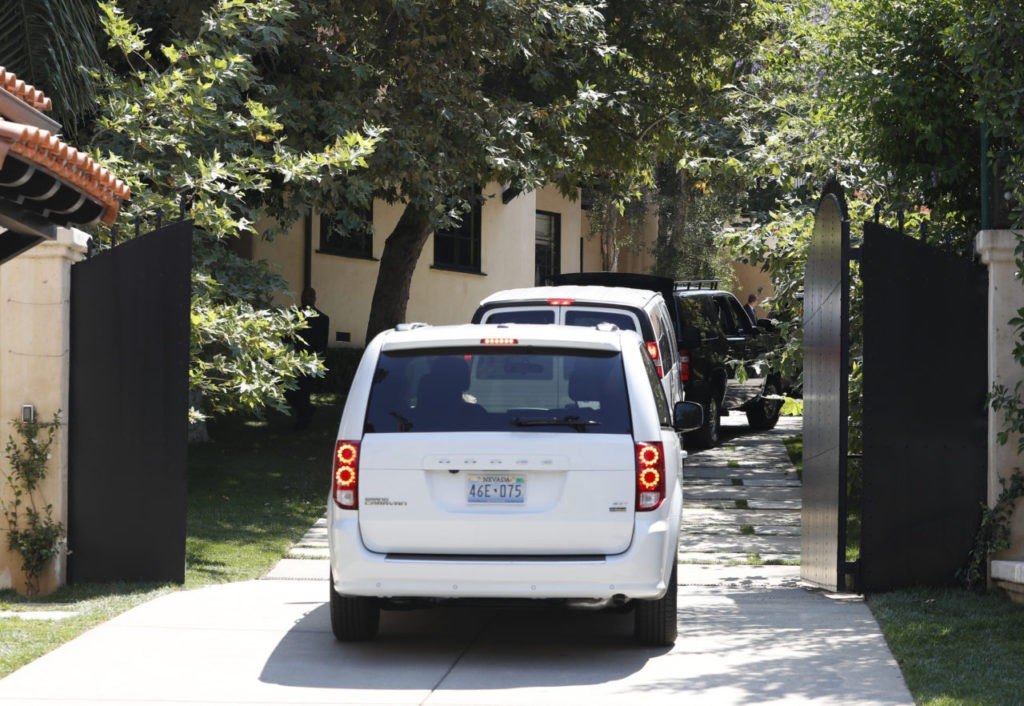 Democratic presidential candidate Hillary Clinton's motorcade drives through the gate at the home Justin Timberlake and Jessica Biel in Los Angeles, Tuesday, Aug. 23, 2016, as Clinton arrives for a fundraiser. (AP Photo/Carolyn Kaster)