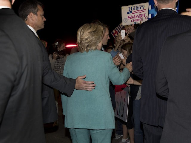 Democratic presidential nominee Hillary Clinton is surrounded by members of her Secret Service detail as she greets people before leaving a fundraiser in Piedmont, Calif., Tuesday, Aug. 23, 2016. (AP Photo/Carolyn Kaster)