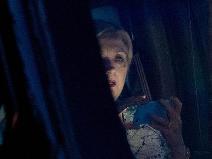 Democratic presidential candidate Hillary Clinton looks on as she was looking at a smartphone when she leaves a fundraiser at a private home in Southampton, N.Y., Sunday, Aug. 28, 2016. (AP Photo/Andrew Harnik)