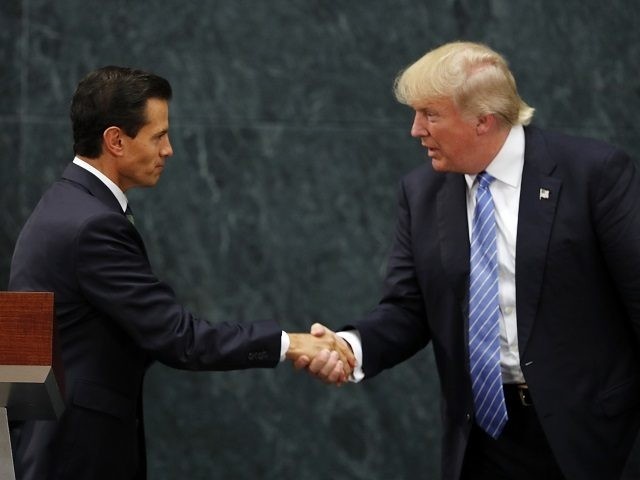 Mexico President Enrique Pena Nieto and Republican presidential nominee Donald Trump shake hands after a joint statement at Los Pinos, the presidential official residence, in Mexico City, Wednesday, Aug. 31, 2016. Trump is calling his surprise visit to Mexico City Wednesday a 'great honor.' The Republican presidential nominee said after …