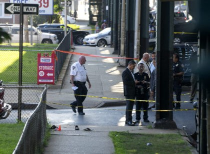 Sandals mark the crime scene, Saturday, Aug. 13, 2016, not far from the Al-Furqan Jame Masjid Mosque in the Ozone Park neighborhood of Queens, New York, where the leader of a New York City mosque has been fatally shot and an associate has been wounded in a brazen daylight attack. …