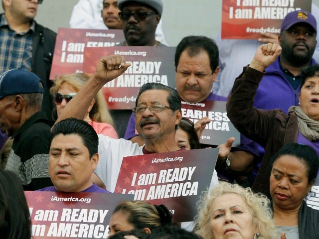 Community activists rally during an event on Deferred Action for Childhood Arrivals, DACA and Deferred Action for Parental Accountability, DAPA in downtown Los Angeles, Tuesday, Feb. 17, 2015. The White House promised an appeal Tuesday after a federal judge in Texas temporarily blocked President Barack Obama's executive action on immigration …