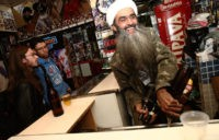 SAO PAULO, BRAZIL - APRIL 29: Osama bin Laden lookalike Ceara Francisco Helder Braga Fernandes (R) serves customers in his 'Bar do Bin Laden' on April 29, 2014 in Sao Paulo, Brazil. Braga says he was known as the 'Beard Man' before 9/11 but became known as a Bin Laden …