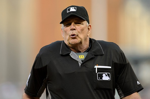 MINNEAPOLIS, MN - JULY 01: Home plate umpire Bob Davidson #61 looks on during the game between the Minnesota Twins and the Texas Rangers on July 1, 2016 at Target Field in Minneapolis, Minnesota. The Rangers defeated the Twins 3-2 in ten innings. (Photo by Hannah Foslien/Getty Images)