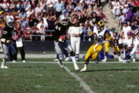 LOS ANGELES - DECEMBER 18:  Defensive end Burgess Owens #44 of the Los Angeles Raiders runs with the ball past wide receiver Willie Miller #82 of the Los Angeles Rams during the game at the Los Angeles Memorial Coliseum on December 18, 1982 in Los Angeles, California.  The Raiders won 37-31.  (Photo by George Rose/Getty Images)