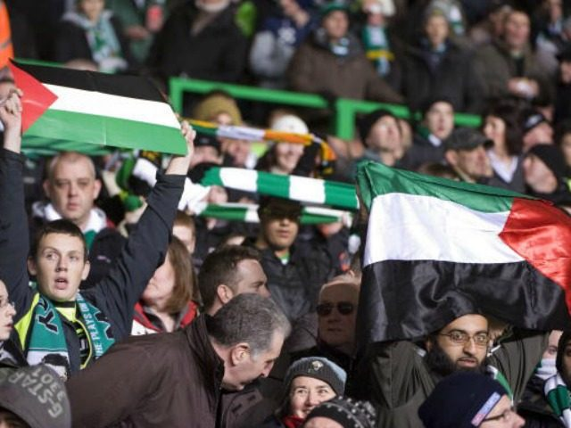Celtic supporters and demonstrators show support for Palestinians at the match between Hapoel Tel Aviv and Celtic, during their European League football match at Celtic Park, in Glasgow, Scotland, on December 2, 2009. AFP PHOTO / DEREK BLAIR (Photo credit should read Derek Blair/AFP/Getty Images)