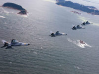 China : JH-7 fighter-bombers of the Jinan Military Region of Chinas PLA Air Force fly over islands during a combat training, 4 September 2012. China is stepping up live-ammunition combat trainings over island dispute with Japan.