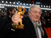 French director Claude Lanzmann poses with his honoury Golden Bear on the red carpet for the awards ceremony of the 63rd Berlinale Film Festival, in Berlin on February 16, 2013. AFP PHOTO / GERARD JULIEN (Photo credit should read GERARD JULIEN/AFP/Getty Images)