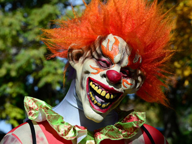 Clown near woods - getty